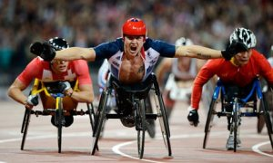 Chariot of fire: David Weir triumphant after winning one of his four Paralympic gold medals this year