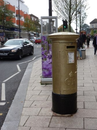 One of the four golden post boxes in Wallington for David Weir, this one on Woodcote Road