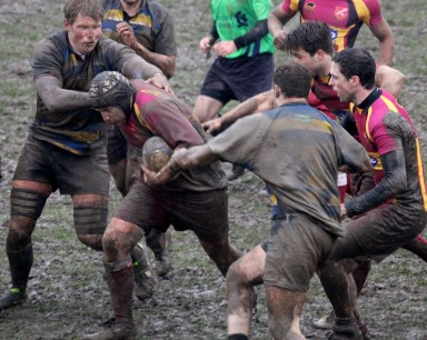 Muddy marvel: Old Ruts defenders try to get to grips with Streatham-Croydon's Ollie Goldsmith at Frant Road last weekend