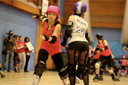 """Contact sport: Croydon's """"Mosquito"""", with her back to camera, makes a block in the bout with Batter C Power. Photographs by Vicky Walters"""