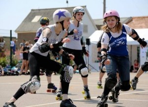 Croydon Roller Derby's President Garfield (left, with star on her helmet) takes on Portsmouth's Malibash Stacey in the recent Eastbourne Extreme. Photograph by Vicky Walters