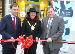Croydon's Mayor, Yvette Hopley, together with Chris Burchell, the managing director for Southern Rail, left, and florid-faced Mike Fisher, the leader of the council, cut the ribbon to open the new pedestrian bridge at East Croydon. At the western end. The eastern end remains firmly unconnected