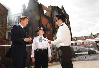 Always ready for a photo op: PM David Cameron in Croydon in August 2011. What has he done to fulfill promises to the victims?