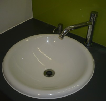 The newly fitted, longer spouted automatic sensor tap, the kind which is being fitted in a rush at all the toilet sinks in Fisher's Folly, less than six months after the building opened