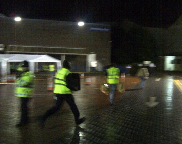 Council staff, suitably with police escort, run in the first ballot boxes of the night for the count