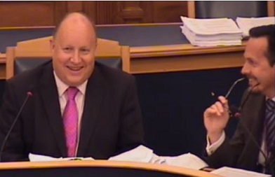 Council Leader Tony Newman and his choice of CEO, Nathan Elvery, share a joke at a council meeting