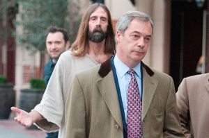 A cross Farage has to bear: the UKIP leader looked less than delighted when he had a stalker following another McKenzie gaffe
