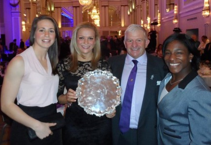 Kay Wilson with the SJA's Team of the Year trophy, alongside Emily Scarratt (left) and Maggie Alphonsi, with current Warlingham first XV team manager, Tony Doe at Thursday's SJA British Sports Awards