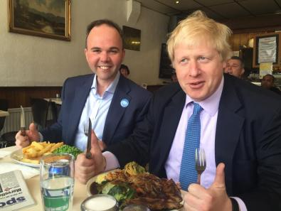 """Just like school dinners, what!"": Boris and Barwell tuck in at the New Cafe, which hs a 1-star hygiene rating"