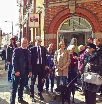 Steve Reed, left, with Robert Gibson and a group of library users in Upper Norwood yesterday