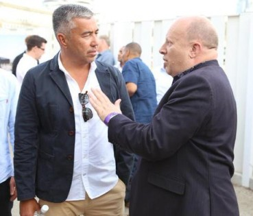 "Croydon Council leader Tony Newman in discussion with Boxpark's Roger wade last night: ""So, after that £3m loan from the council, is there a discount on burgers on our way back from watching Fulham?"""