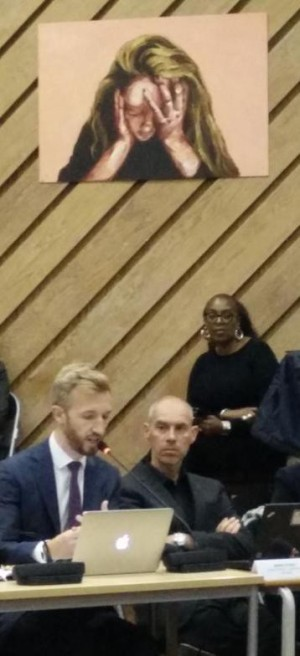 Apt: the pupil's picture in Dunraven School hall, above members of Lambeth Council's cabinet, somes up the mood of the body of the hall last night