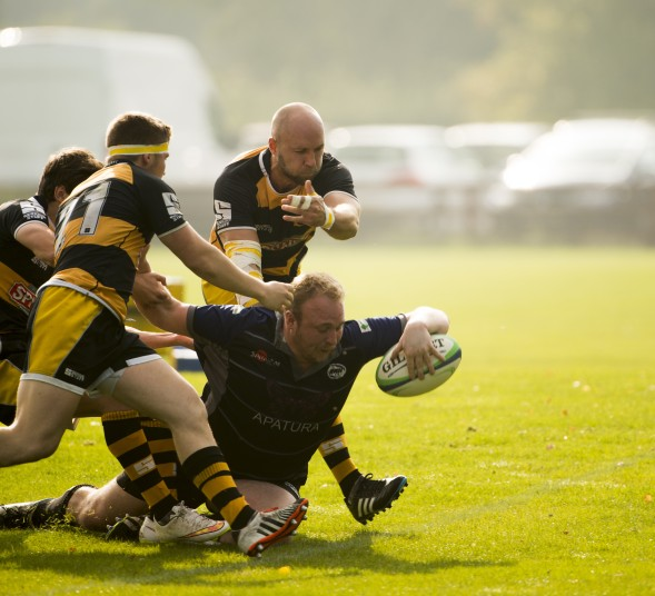 Nathan Bacon shrugs off the challenges to scores a try for MidWives in one of their early season matches