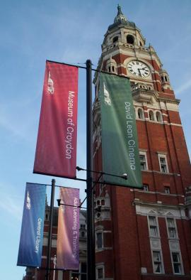 New banners, with the old logos and names, outside the Clocktower arts complex this week
