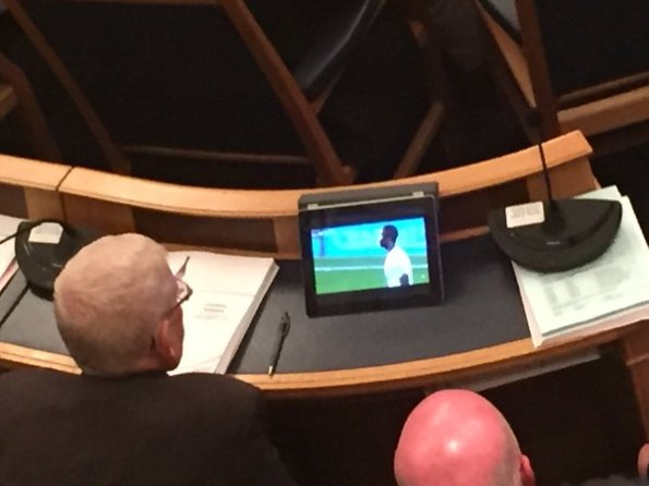 Watching football in council meeting