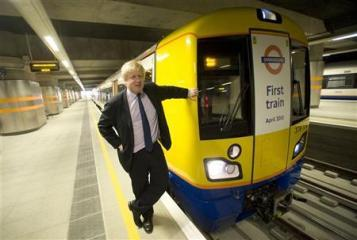 London Mayor Boris Johnson poses next to a new train at Dalston Junction station in London April 27, 2010. REUTERS/Jas Lehal
