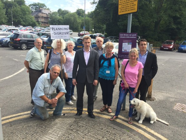Down with this sort of thing: An MP stands in a car park with some passers-by