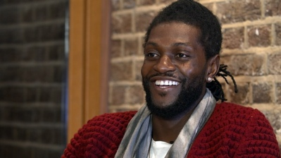Emmanuel Adebayor at his signing announcement last week: will he be smiling once he's playing for Palace?