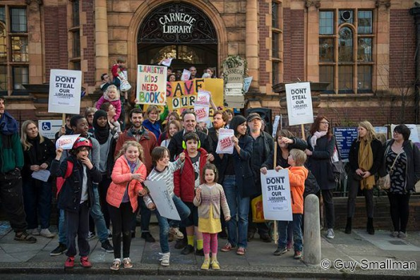 Protestors gather outside Lambeth's Carnegie Library in Herne Hill yesterday, before the occupation against its closure