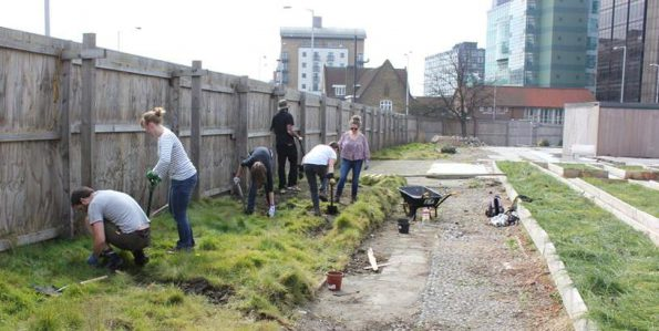 Volunteers at work on the town centre bee haven last weekend
