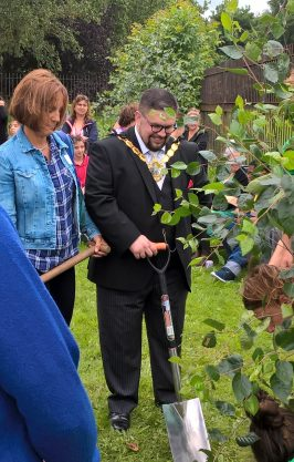 Dug in: Wayne Trakas-Lawlor, the Mayor of Croydon, opens the edible garden at St Giles School today