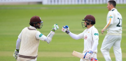 Surrey's Steven Davies (left) congratulates Tom Curran after reaching his half century against Nottinghamshire.