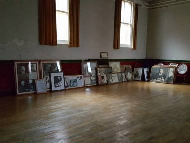 Pictures from the former Wetherspoons on South Norwood High Street await hanging at Stanley Halls