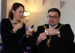 Croydon Mayor Wayne Trakas-Lawlor selects the raffle winners with fundraiser Eleanor Appleton
