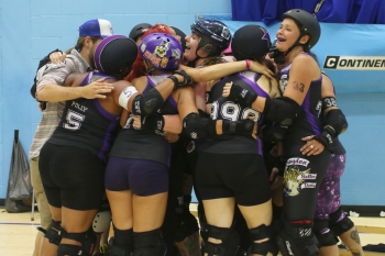 Croydon Roller Derby's Riot Squad team celebrate a win in a recent match