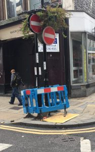 Beware - Men Not at Work: double signs and random holes in the road. How is Skanska doing?