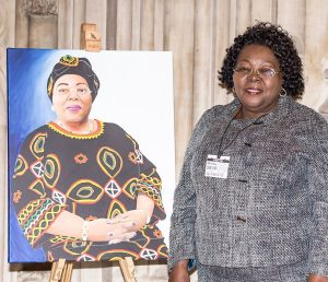 Lucy Njomo with her portrait, which is on display at the House of Commons