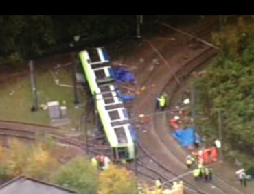 This shot from the BBC, taken from a helicopter, shows the position of the derailed tram