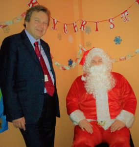 Ho, ho, ho: Councillor Pelling with the special police Santa