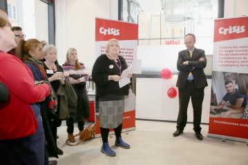 Croydon councillor Alison Butler addressing this morning's Crisis centre oopening, watched by the Nimby housing minister